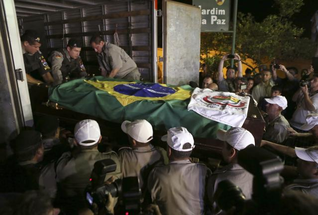 The exhumed remains of Brazil's former president Joao Goulart are carried from the Jardim da Paz cemetery in Sao Borja, in Rio Grande do Sul state early November 14, 2013. Authorities exhumed the remains of Goulart 37 years after he was laid to rest. The former head of state's remains will undergo a new autopsy amid allegations he may have been poisoned. Goulart, who was elected president in 1961, was deposed from office in 1964 by a military coup. He fled to Uruguay and then Argentina, where in 1976 he died in his sleep of an apparent heart attack. REUTERS/Edison Vara (BRAZIL - Tags: POLITICS)