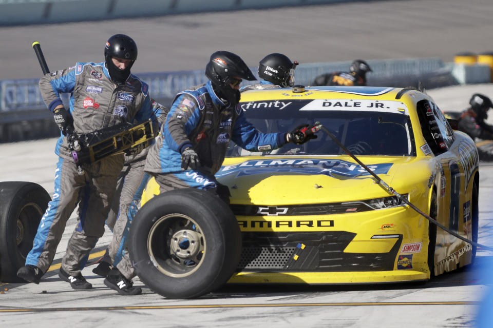 Dale Earnhardt Jr. makes a pit stop during a NASCAR Xfinity Series auto race Saturday, June 13, 2020, in Homestead, Fla. (AP Photo/Wilfredo Lee)