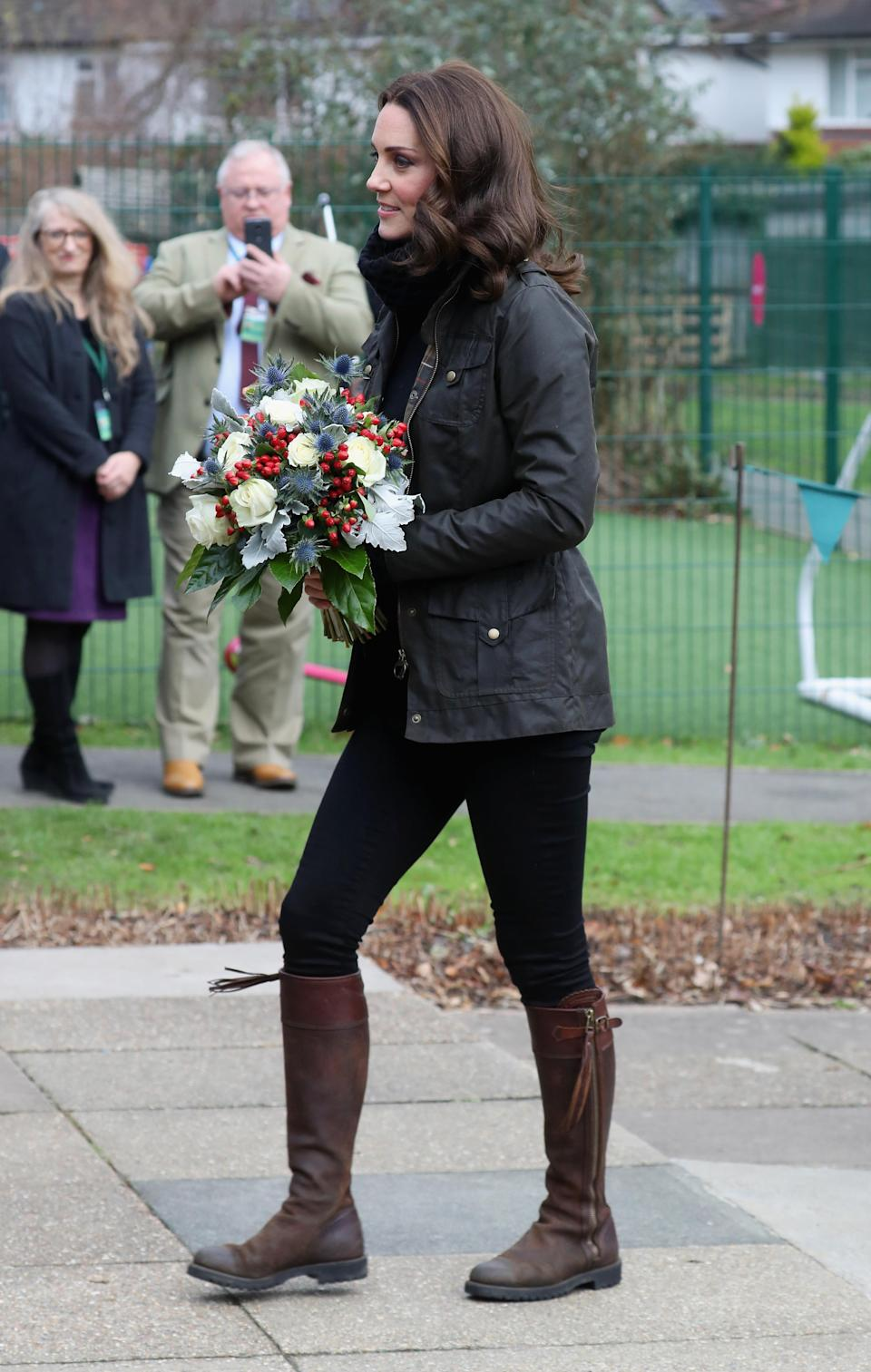 <p>The Duchess arrived at London's Robin Hood Primary School wearing a turtleneck knit by Temperley, her trusty skinny black jeans and a Barbour jacket. She finished with brown leather Penelope Chilvers boots that she first wore back in 2005. <i>[Photo: Getty]</i> </p>