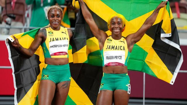 Elaine Thompson-Herah, left, of Jamaica, celebrates after winning the women's 100-meters final with teammate Shelly-Ann Fraser-Pryce at the 2020 Summer Olympics. AP