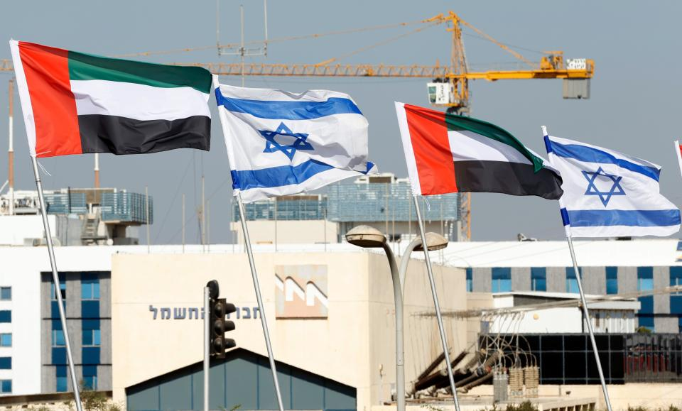 Israeli and United Arab Emirates flags line a road in the Israeli coastal city of Netanya, on August 16, 2020. Photo: Jack Guez / AFP via Getty Images