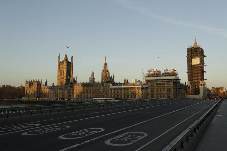 FILE - In this Tuesday, March 24, 2020 file photo an almost empty Westminster Bridge stands backdropped by the early morning sun on the scaffolded Houses of Parliament and the Elizabeth Tower, known as Big Ben, on the first day of Britain's first lockdown to try to fight the spread of coronavirus, in London. The crisis facing Britain this winter is depressingly familiar: Stay-at-home orders and empty streets. Hospitals overflowing. A daily toll of many hundreds of coronavirus deaths. (AP Photo/Matt Dunham, File)