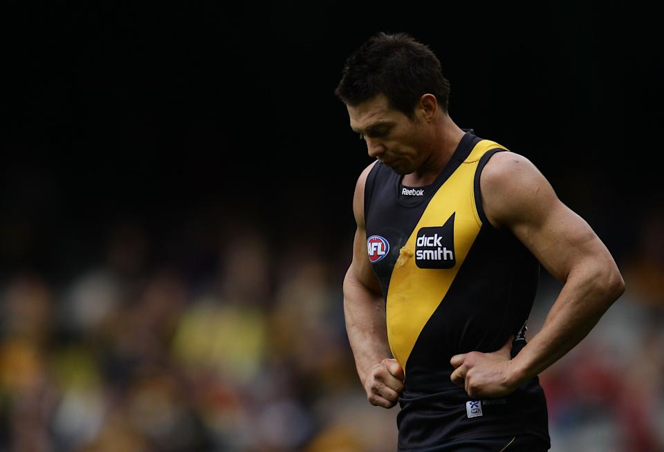 Ben Cousins of the Tigers leaving the field looking dejected.