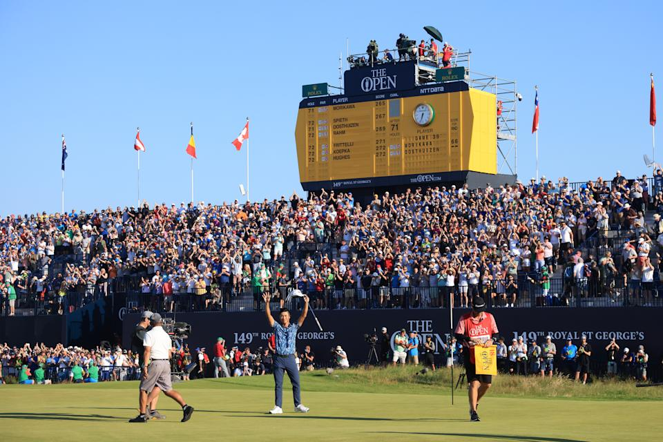 SANDWICH, ENGLAND - JULY 18: Collin Morikawa of the United States celebrates after his putt on the 18th hole as fans applaud during Day Four of The 149th Open at Royal St George's Golf Club on July 18, 2021 in Sandwich, England. (Photo by Andrew Redington/Getty Images)