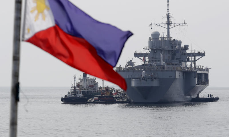 "The USS Blue Ridge (LCC-19), the U.S. 7th Fleet Flagship, is anchored off Manila Bay west of Manila, Philippines for a routine port call Wednesday, March 13, 2019. Capt. Eric Anduze, Commander of the USS Blue Ridge, renewed an American vow to ""sail, fly and operate wherever the law allows us to"" amid China's objection to U.S. military presence in the disputed South China Sea. (AP Photo/Bullit Marquez)"