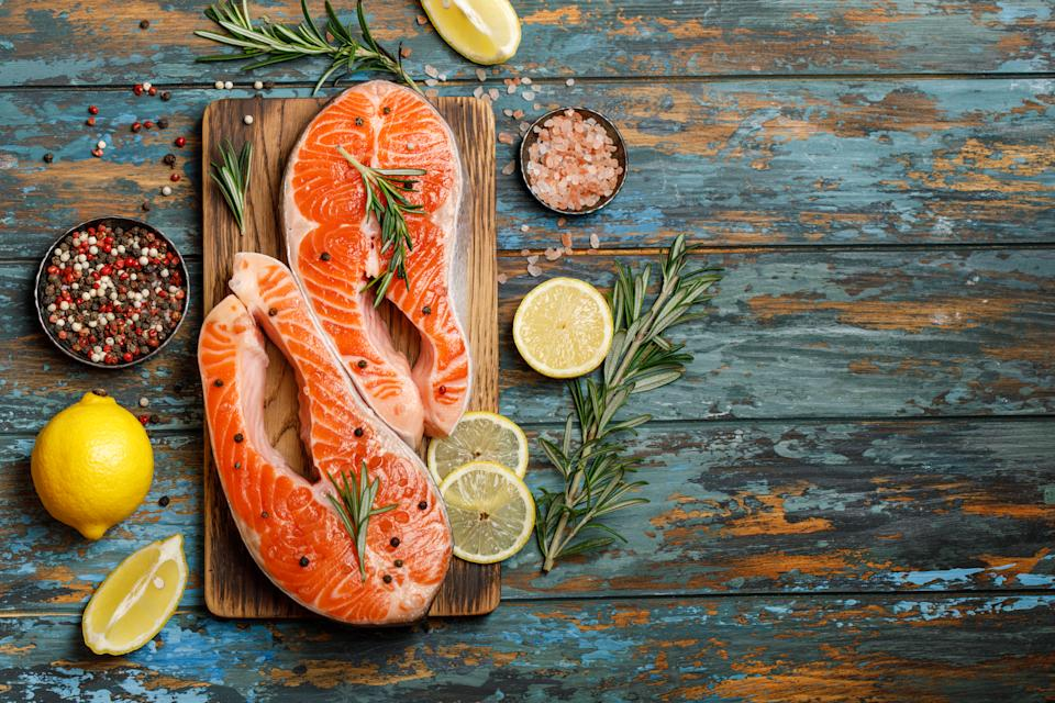 Salmon. Raw trout red fish steak with ingredients for cooking. Cooking Salmon, sea food. Healthy eating concept
