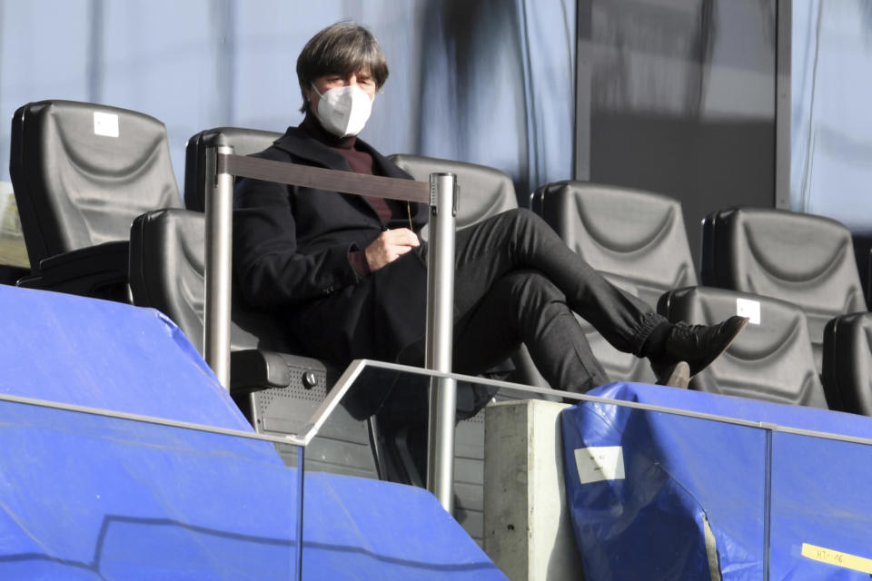 German national soccer team coach Joachim Loew sits in the stands prior to the German Bundesliga soccer match between Eintracht Frankfurt and Bayern Munich in Frankfurt, Germany, Saturday, Feb. 20, 2021. (Arne Dedert/POOL via AP)
