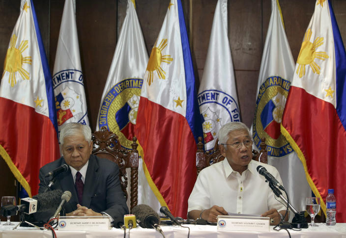 Philippine Defense Secretary Voltaire Gazmin, right, talks beside Foreign Secretary Albert del Rosario during a press conference at Camp Aguinaldo military headquarters in suburban Quezon City, north of Manila, Philippines on Monday, Aug. 12, 2013. Philippine officials said Monday they will make sure that an increased presence of U.S. troops in the country does not become permanent and is meant to help the Philippines modernize its military, which is being challenged by China in territorial disputes in the South China Sea.(AP Photo/Aaron Favila)