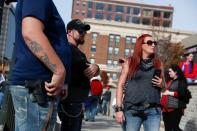 People carry firearms outside the TCF Center as supporters of U.S. President Donald Trump rally as votes continue to be counted following the 2020 U.S. presidential election, in Detroit