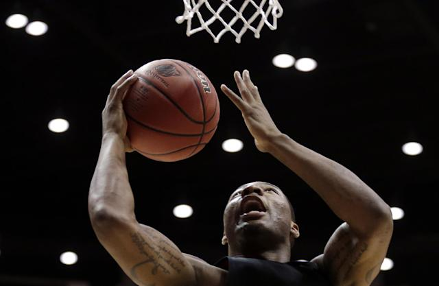 Oklahoma State guard Marcus Smart shoots during practice at the NCAA college basketball tournament Thursday, March 20, 2014, in San Diego. Oklahoma State faces Gonzaga in a second-round game on Friday. (AP Photo/Gregory Bull)