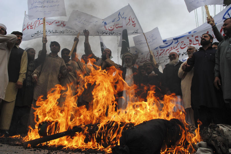 FILE - In this Thursday, Dec. 1, 2011 file photo, Pakistani protesters burn an effigy of US President Barrack Obama during a protest to condemn killings of Pakistani troops  in NATO airstrikes, in Peshawar, Pakistan. Pakistan's army on Monday formally rejected a U.S. claim that American airstrikes that killed 24 Pakistani troops last year were justified as self-defense, a stance that could complicate efforts to repair the troubled but vital relationship between the two countries.(AP Photo/Mohammad Sajjad, File)