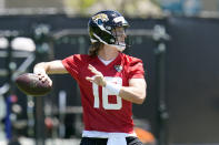 Jacksonville Jaguars quarterback Trevor Lawrence looks for a receiver during an NFL football rookie minicamp, Saturday, May 15, 2021, in Jacksonville, Fla. (AP Photo/John Raoux)