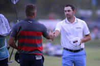 Patrick Cantlay, right, shakes hands with Bryson DeChambeau after Cantlay won their sixth playoff hole of the final round of the BMW Championship golf tournament, Sunday, Aug. 29, 2021, at Caves Valley Golf Club in Owings Mills, Md. (AP Photo/Nick Wass)