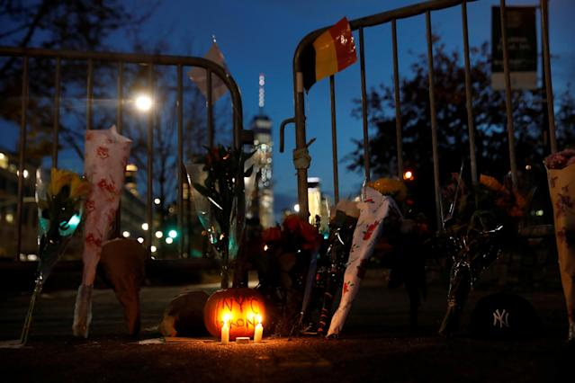 <p>A makeshift memorial for victims of Tuesday's attack is seen outside a police barricade on the bike path next to West Street, a day after a man driving a rented pickup truck mowed down pedestrians and cyclists on a bike path alongside the Hudson River in New York City, in New York, Nov. 1, 2017. (Photo: Shannon Stapleton/Reuters) </p>