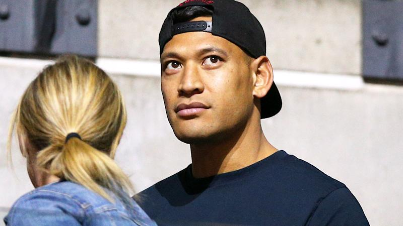 Israel Folau, pictured here watching his wife at the Netball World Cup.