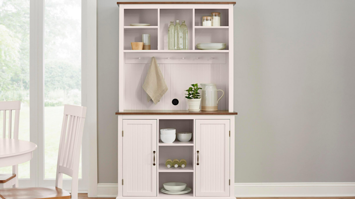 Less obtrusive than a large kitchen island, this buffet offers extra storage and counter space.