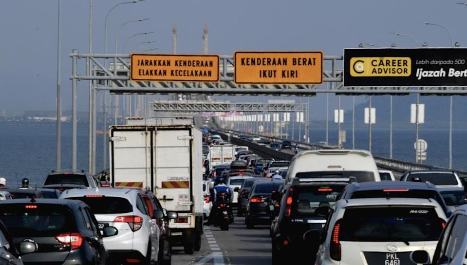Traffic is at a standstill after a power cable under the Penang Bridge at KM3.2 caught fire in George Town, February 22, 2021. — Bernama pic