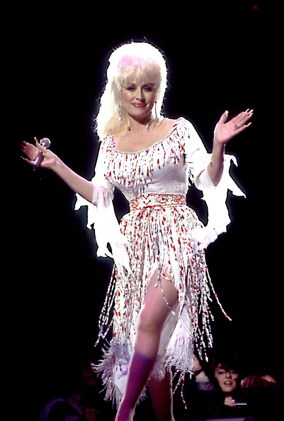 <p>During a concert in 1986, Parton wears something completely out of character: A ponytail. </p>