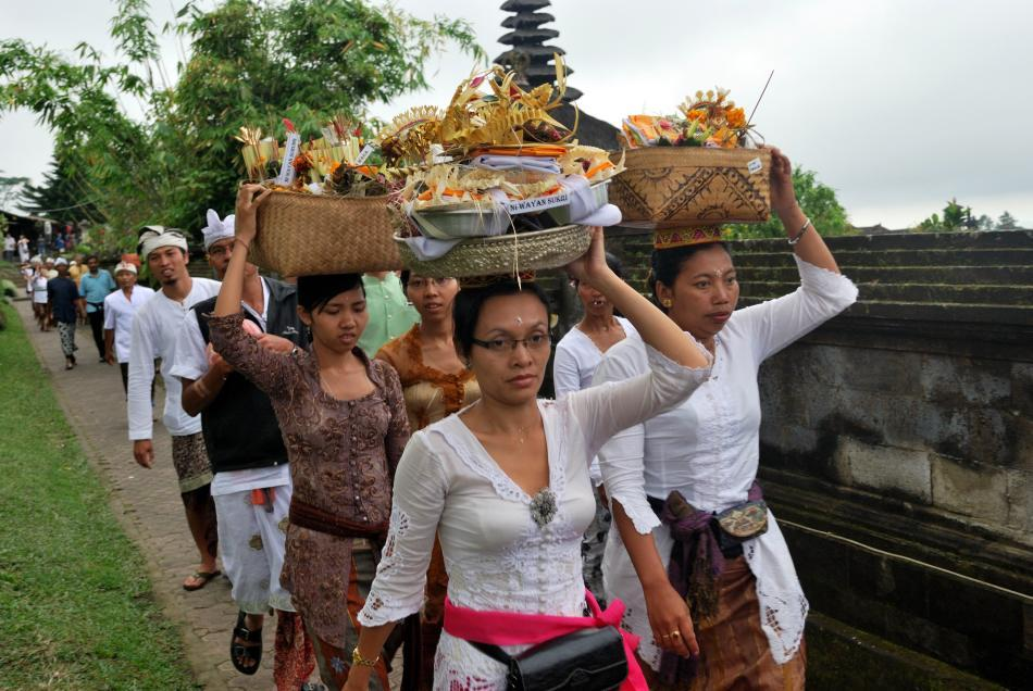 <b>Balinese Hindus at the Mother Besakih Temple in Bali, Indonesia</b><br><br>The Mother Besakih temple is one of the most important temples in Bali. It is located atop Mount Agung. It is not just one shrine but a cluster of 20 temples overlooking the villages and the green slopes of the mountain. Balinese believe that the good spirits along with their deities reside here and the shrines resemble houses built for them.
