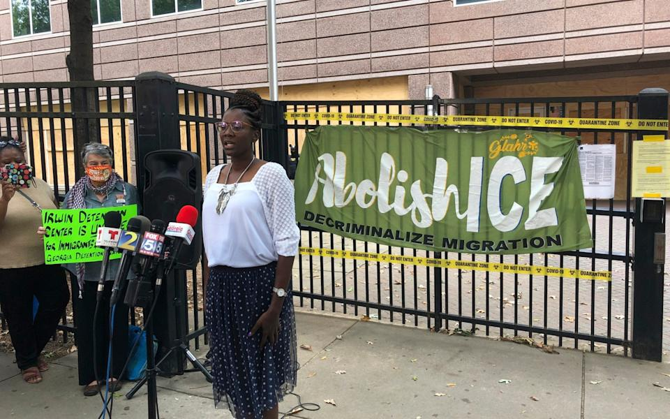 Nurse Dawn Wooten speaks at a news conference where she accused ICE of performing hysterectomies on immigrants who did not consent - Jeff Amy/AP
