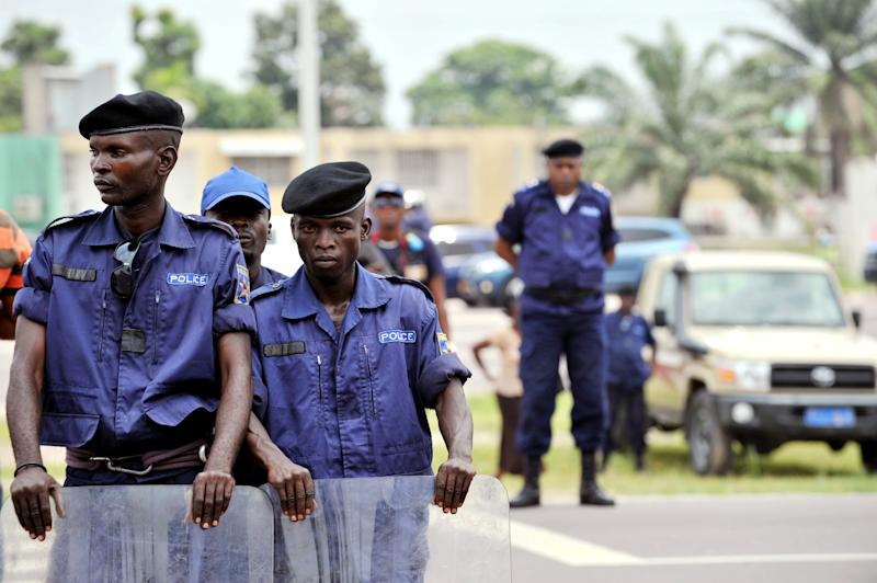 Police officers stand watch at a march in Kinshasa on February 16, 2013, to protest against the rule of President Joseph Kabila, in spite of a ban