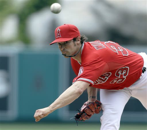 Los Angeles Angels starter C.J. Wilson pitches to the Houston Astros Los in the first inning of an interleague baseball game in Anaheim, Calif., Sunday April 14, 2013. (AP Photo/Reed Saxon)