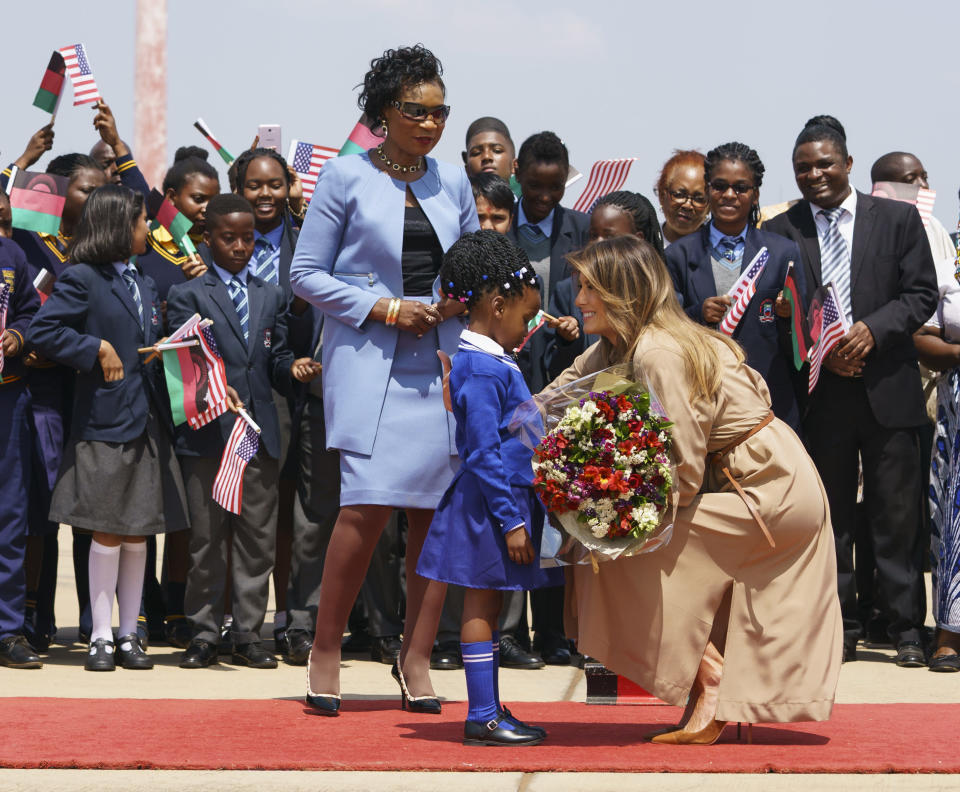 Melania Trump was greeted by a young girl and Gertrude Maseko, the first lady of Malawi, upon her arrival Thursday. (Photo: Carolyn Kaster/AP)