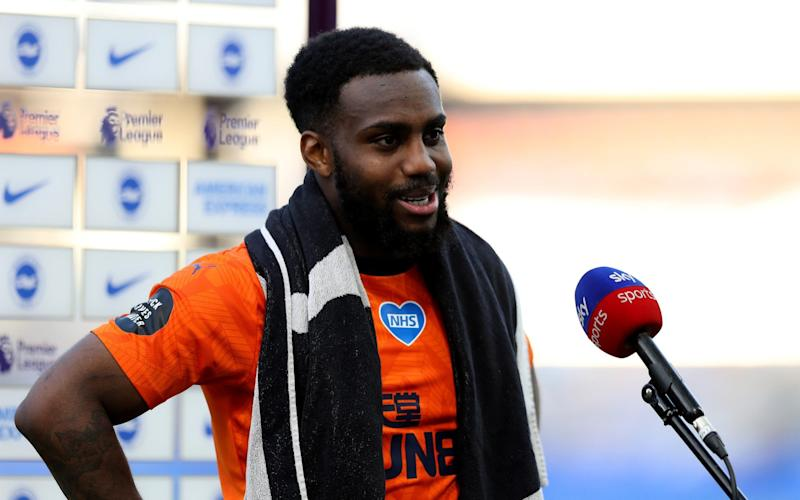 Danny Rose of Newcastle United speaks to the media pitchside after the Premier League match between Brighton & Hove Albion and Newcastle United  - Getty Images