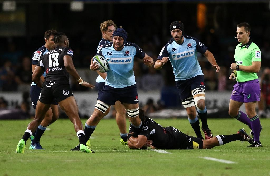 Waratahs' Dean Mumm (C), seen in action during their Super Rugby match against Sharks, at the Kings Park in Durban, on March 11, 2017 (AFP Photo/ANESH DEBIKY)