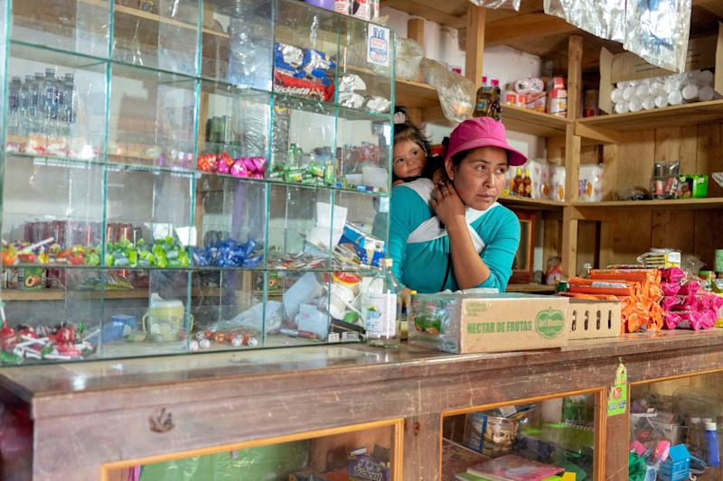 IXCHIGUAN, Guatemala – Cristina Roblero, 33, runs a small store on the first floor of her wood house to earn extra money. Roblero, an indigenous Mayan woman, is considering heading to the U.S. with her three children, including 1-year-old Maddy, to escape extreme poverty in the western highlands of Guatemala.