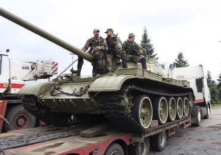 Separatist rebels remove a Soviet era T-54 tank from a historical museum in Donetsk July 7, 2014. REUTERS/Stringer
