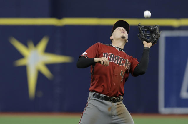 Arizona Diamondbacks first baseman Wilmer Flores makes the catch on a popout by Tampa Bay Rays' Willy Adames during the 13th inning of a baseball game Wednesday, May 8, 2019, in St. Petersburg, Fla. (AP Photo/Chris O'Meara)
