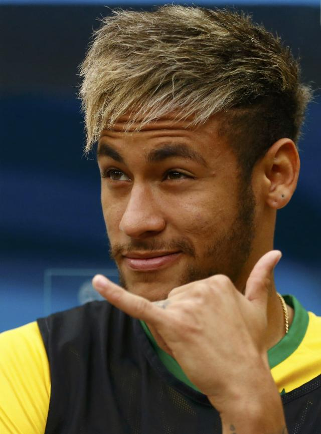 Brazil's Neymar gestures on the bench before the start of their 2014 World Cup third-place playoff against the Netherlands at the Brasilia national stadium in Brasilia July 12, 2014. REUTERS/Dominic Ebenbichler (BRAZIL - Tags: SOCCER SPORT WORLD CUP)