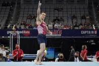 Sam Mikulak celebrates after competing in the floor exercise during the U.S. Gymnastics Championships, Saturday, June 5, 2021, in Fort Worth, Texas. (AP Photo/Tony Gutierrez)