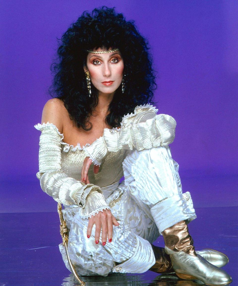 <p>Cher's hairspray was certainly 'Strong Enough' when she rocked this outfit that can only be described as 'Shakespearean Chic,' and paired it with big '80s hair in 1981. </p>