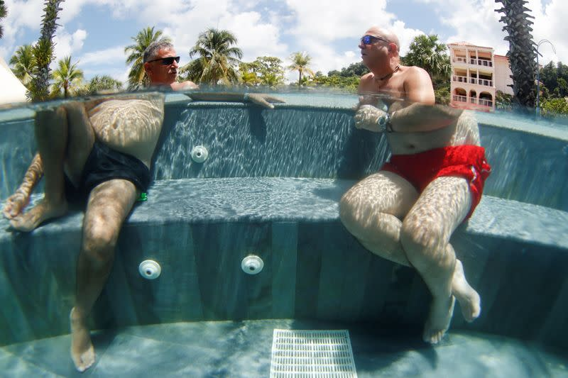 Rotem and Dani, newly-arrived tourists from Israel, enjoy a jacuzzi as Phuket reopens to overseas tourists, in Thailand