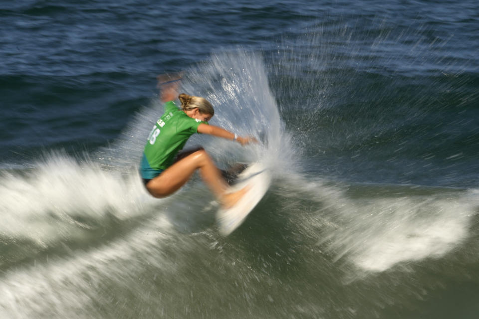 Israel's Anat Lelior maneuvers on a wave during the second round of the women's surfing at the 2020 Summer Olympics, Sunday, July 25, 2021, at Tsurigasaki beach in Ichinomiya, Japan. (AP Photo/Francisco Seco)