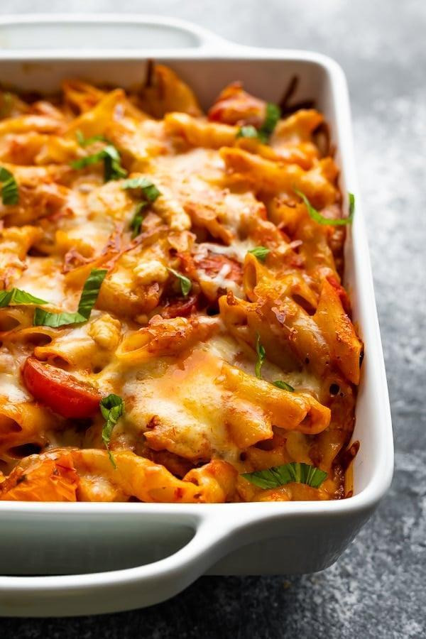 """<p>This pasta bake is comfort food at its finest. It can be prepped, baked, and then refrigerated or frozen until you are ready to slice and serve. We suggest making a double batch so you have one for now and one to freeze for later.</p> <p><strong>Get the recipe:</strong> <a href=""""https://sweetpeasandsaffron.com/chicken-caprese-pasta-bake/"""" class=""""link rapid-noclick-resp"""" rel=""""nofollow noopener"""" target=""""_blank"""" data-ylk=""""slk:chicken caprese pasta bake"""">chicken caprese pasta bake</a></p>"""