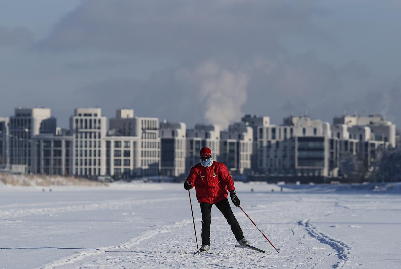 A skier walks on the ice-covered Rowing Channel in St. Petersburg, Russia February 22, 2018. REUTERS/Maxim Shemetov     TPX IMAGES OF THE DAY