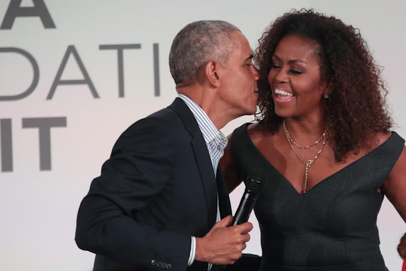 CHICAGO, ILLINOIS - OCTOBER 29: Former U.S. President Barack Obama gives his wife Michelle a kiss as they close the Obama Foundation Summit together on the campus of the Illinois Institute of Technology on October 29, 2019 in Chicago, Illinois. The Summit is an annual event hosted by the Obama Foundation. (Photo by Scott Olson/Getty Images)