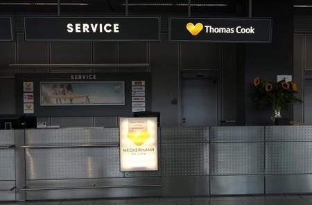 """An announcement at a Thomas Cook Airlines counter reads """"this counter is closed today"""" at Duesseldorf Airport"""