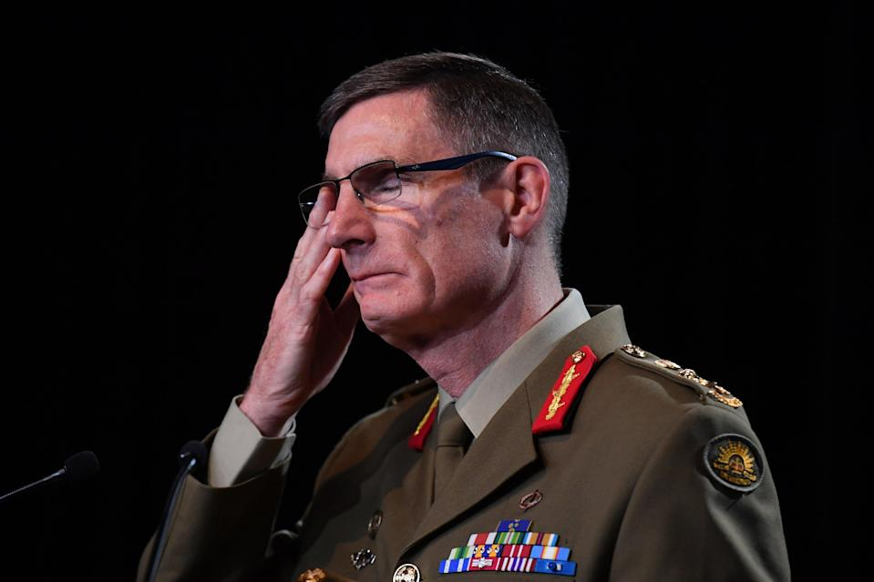 <p>Chief of the Australian Defence Force (ADF) General Angus Campbell delivers the findings from the war crimes report</p>Getty Images