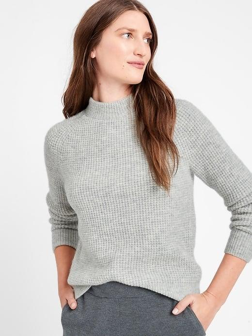 <p>Yes, the <span>Banana Republic Aire Waffle-Knit Sweater</span> ($78, originally $99) comes in a classic gray hue as well.</p>