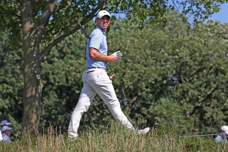 Distracted McIlroy ready to walk out as awaits birth of first child