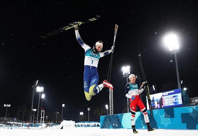 <p>Gold medalist Stina Nilsson of Sweden celebrates winning during the Cross-Country Ladies' Sprint Classic Final on day four of the PyeongChang 2018 Winter Olympic Games at Alpensia Cross-Country Centre on February 13, 2018 in Pyeongchang-gun, South Korea. (Photo by Al Bello/Getty Images) </p>