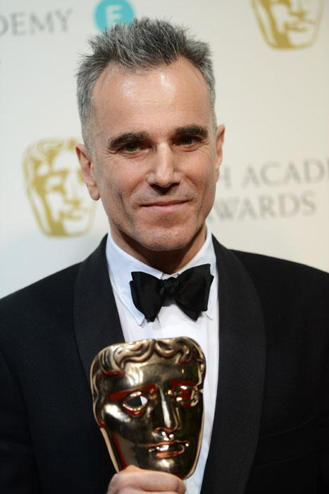 Daniel Day Lewis poses with his Best Actor Award in the press room at The EE British Academy Film Awards 2013 at The Royal Opera House on February 10, 2013 in London, England. (Photo by Dave J Hogan/Getty Images)