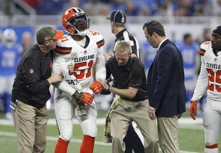 Nov 12, 2017; Detroit, MI, USA; Cleveland Browns outside linebacker Jamie Collins (51) in pain with an injury during the first quarter against the Detroit Lions at Ford Field. Raj Mehta-USA TODAY Sports