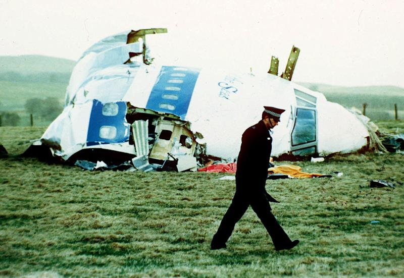 FILE - A police officer walks by the nose of Pan Am flight 103 in a field near the town of Lockerbie, Scotland where it lay after a bomb aboard exploded, killing a total of 270 people, in this December 21, 1988 file photo. The son of the former Libyan intelligence officer convicted of the bombing says his father has died. Abdel Baset al-Megrahi was released in 2009 from his Scottish prison on humanitarian grounds. Al-Megrahi suffered from prostate cancer. His death was announced on Sunday May 20 2012 by his son, Khaled. (AP Photo/Martin Cleaver, File)
