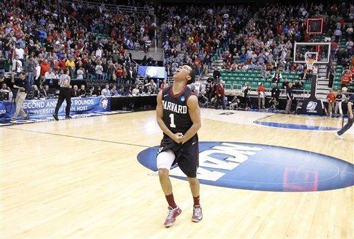 Harvard's Siyani Chambers (1) celebrates after defeating New Mexico 68-62 during a second-round game in the NCAA college basketball tournament in Salt Lake City Thursday, March 21, 2013. (AP Photo/Rick Bowmer)