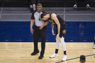 Minnesota Timberwolves forward Juancho Hernangomez (41) leans toward referee Tony Brothers to demonstrate how, he thought, Miami Heat guard Goran Dragic leaned into him to draw a foul during the first half of an NBA basketball game Friday, April 16, 2021, in Minneapolis. (AP Photo/Craig Lassig)